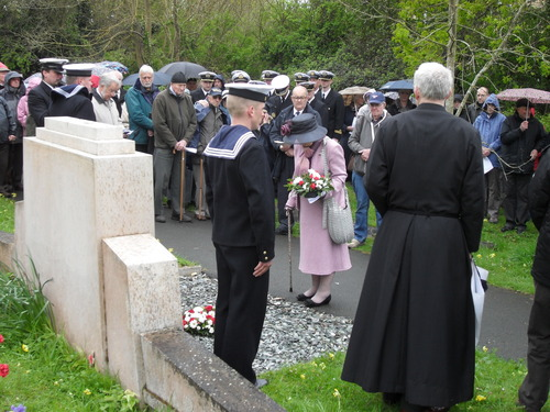 Janina_doroszkowska__captain_francki_s_daughter__lays_flowers_during_the_service_at_the_air_raid_memorial