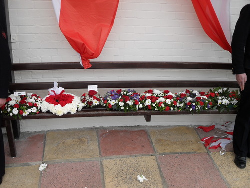 The_wreaths_laid_under_the_commemorative_plaque__cowes_parade_bandstand